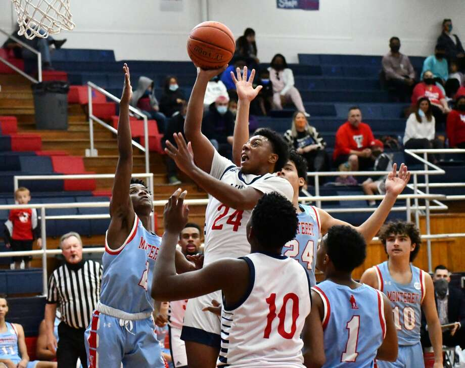 Plainview's Jayvian Lawson shoots over a number of Lubbock Monterey defenders during their non-district boys basketball game on Nov. 24, 2020 in the Dog House at Plainview High School. Photo: Nathan Giese/Planview Herald