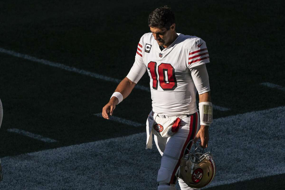 San Francisco 49ers quarterback Jimmy Garoppolo walks off the field after warmups before an NFL football game against the Seattle Seahawks, Sunday, Nov. 1, 2020, in Seattle. The Seahawks won 37-27. (AP Photo/Stephen Brashear)