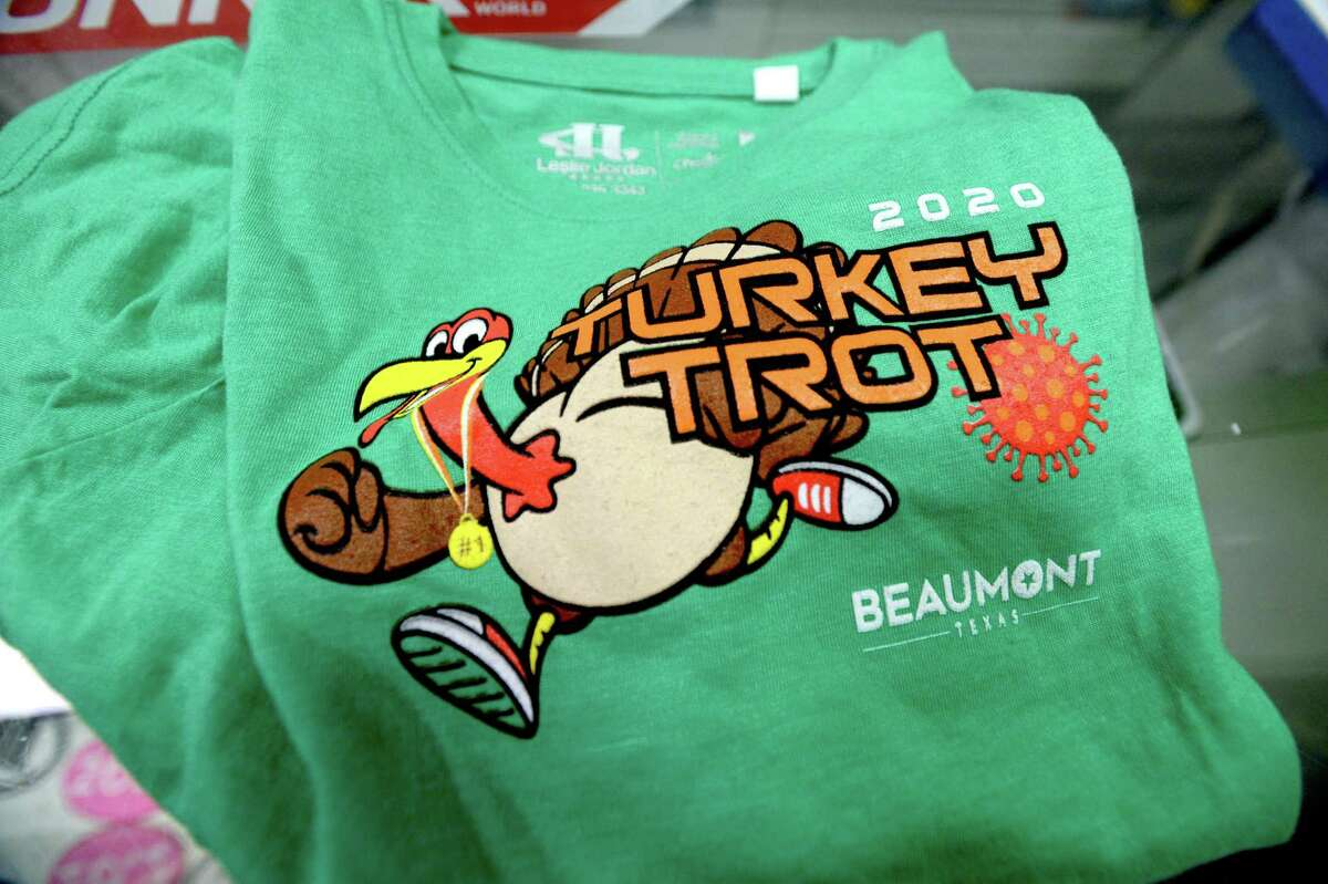 This year's 2020 Turkey Trot swag features a COVID-19 molecule in its design logo. Due to coronavirus, this year's fundraising Turkey Trot will be held virtually, with participants running or walking the 5/10K on their own. Photo taken Tuesday, November 24, 2020 Kim Brent/The Enterprise