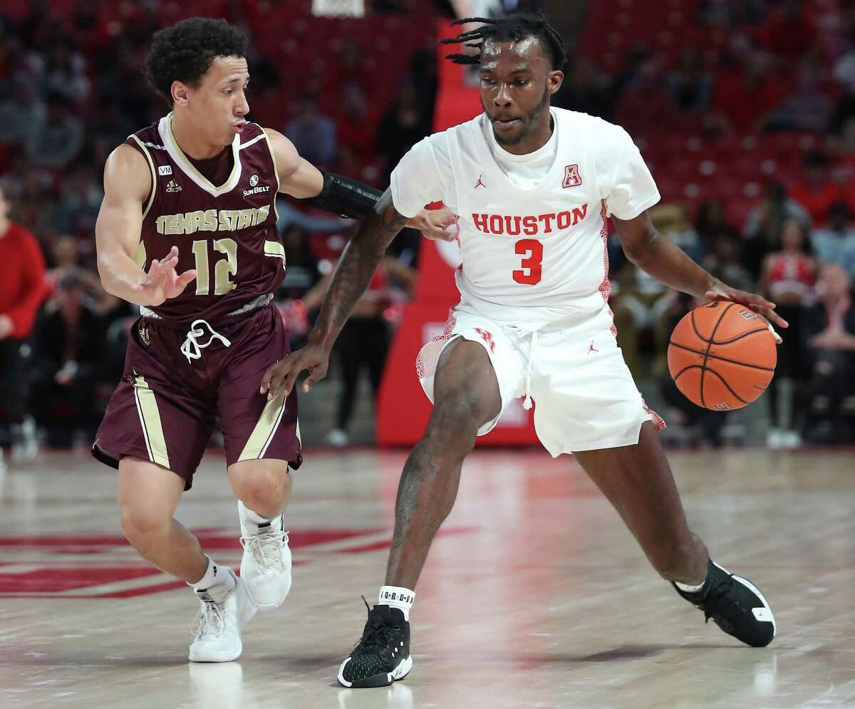 Texas State Bobcats guard Mason Harrell (12) guards Houston Cougars guard DeJon Jarreau (3) during the first half of an NCAA basketball game at Fertitta Center Wednesday, Dec. 4, 2019, in Houston.