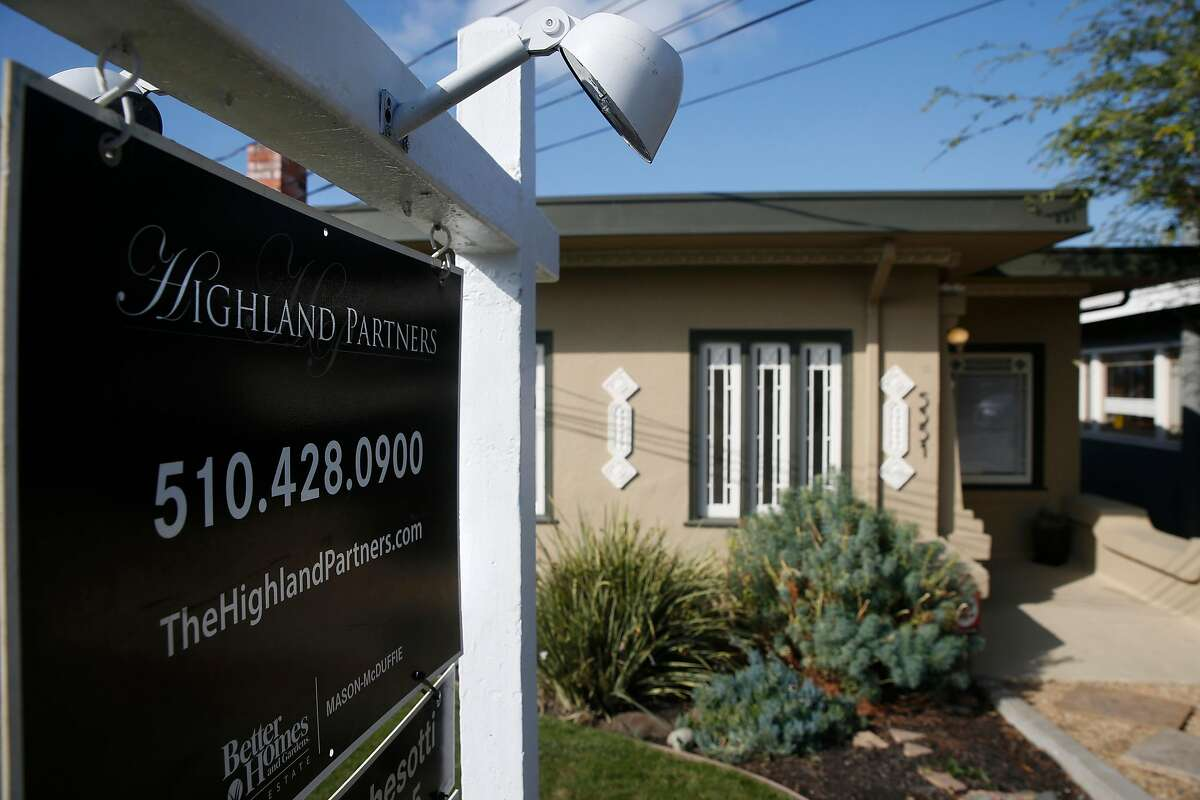 A home is listed for sale on upper Broadway in Oakland, Calif. on Saturday, Nov. 14, 2020.Homeowners will be able to borrow up to $822,375 with a mortgage backed by Fannie Mae or Freddie Mac in most Bay Area counties next year, their regulator announced Tuesday.