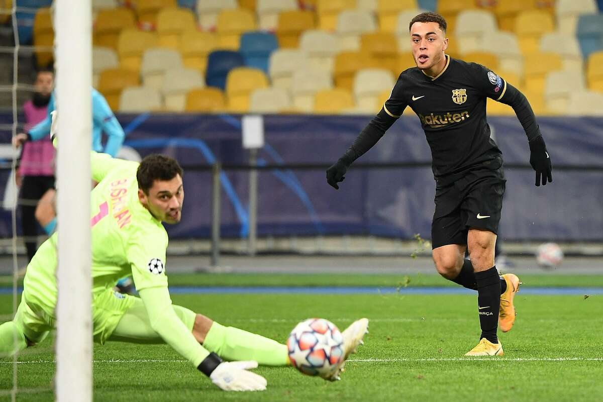 U.S. national team defender Sergino Dest scored his first goal for Barcelona on Nov. 24 during a Champions League match at Dynamo Kiev. He is starting for the Lionel Messi-led team.