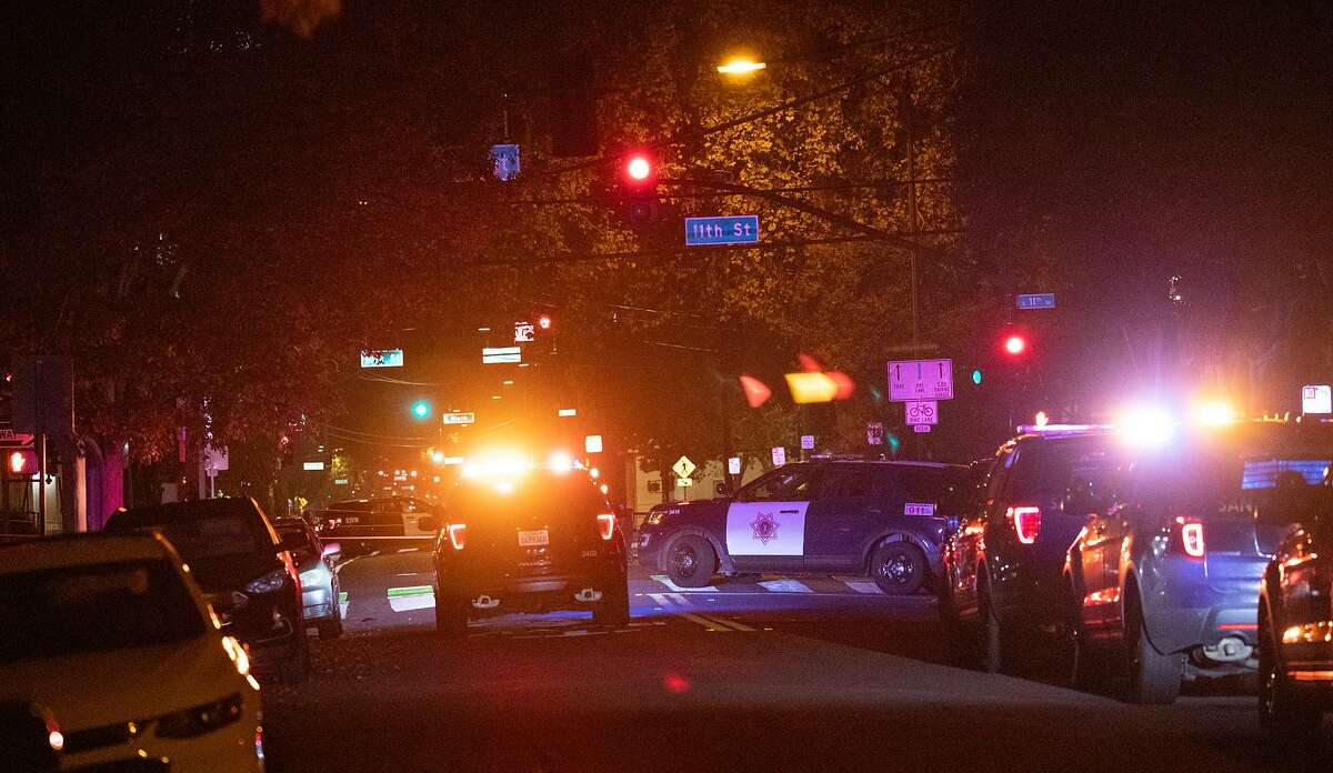 Police vehicles mass on San Fernando Street as the San Jose Police Department investigates a multiple stabbing incident at Grace Baptist Church on Sunday, Nov. 22, 2020, in San Jose, Calif.