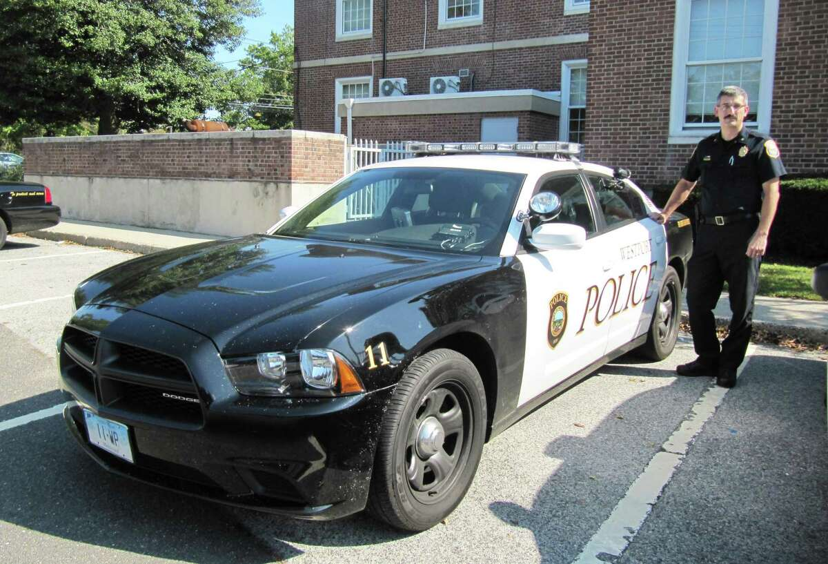 Pictured is Dale Call, deputy chief of the Westport Police Department, posing next to one of the department's newest cruisers, a 2011 Dodge Charger with a new
