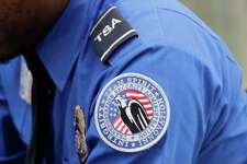 A TSA shoulder patch is shown on the uniform of a Transportation Security Administration officer at John F. Kennedy International Airport, Thursday, Oct. 30, 2014 in New York. (AP Photo/Mark Lennihan)
