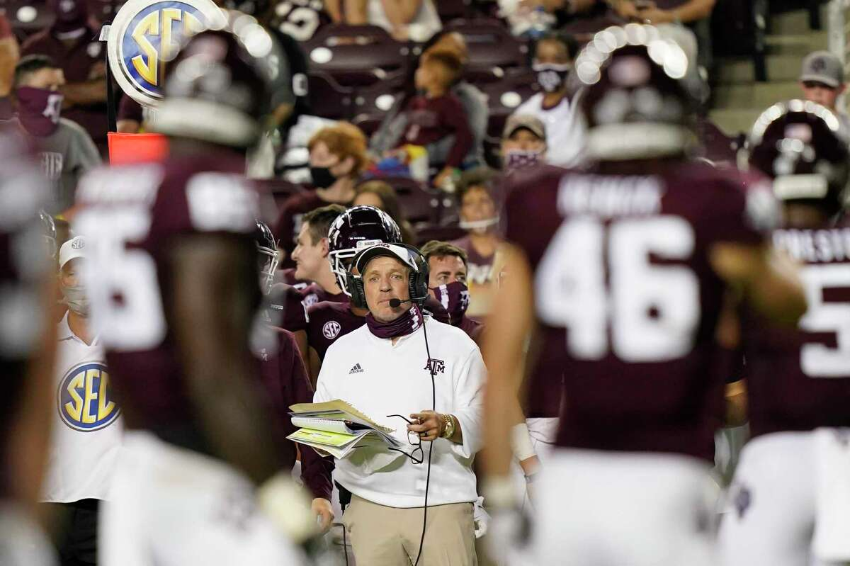 """Texas A&M coach Jimbo Fisher watches from the sideline during the second half of an NCAA college football game against Vanderbilt in College Station, Texas, in this Saturday, Sept. 26, 2020, file photo. The SEC came into this season with a contingency plan to deal with coronavirus-related issues. While those plans have been severely tested as the pandemic has wreaked havoc, Southeastern Conference officials continue adapting to navigate setbacks in their pursuit of a league title and possible national championship. """"Life is about changes,"""" Fisher said. """"It's about adaptation. It's about making the best out of situations."""""""