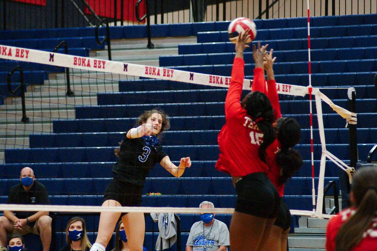Friendswood's Kate Bueche (3) tries to hit a shot past Terry's Gloria Asabi (15) and Terry's Cayla Anthony (2) Tuesday, Nov. 24 at Manvel High School.