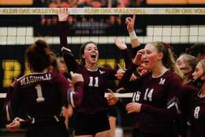 FILE PHOTO — Magnolia setter Faith Lynch (11) celebrates with teammates after sweeping Porter in straight sets a Region III-5A bi-district high school volleyball playoff match at Klein Oak High School, Thursday, Nov. 19, 2020, in Spring.