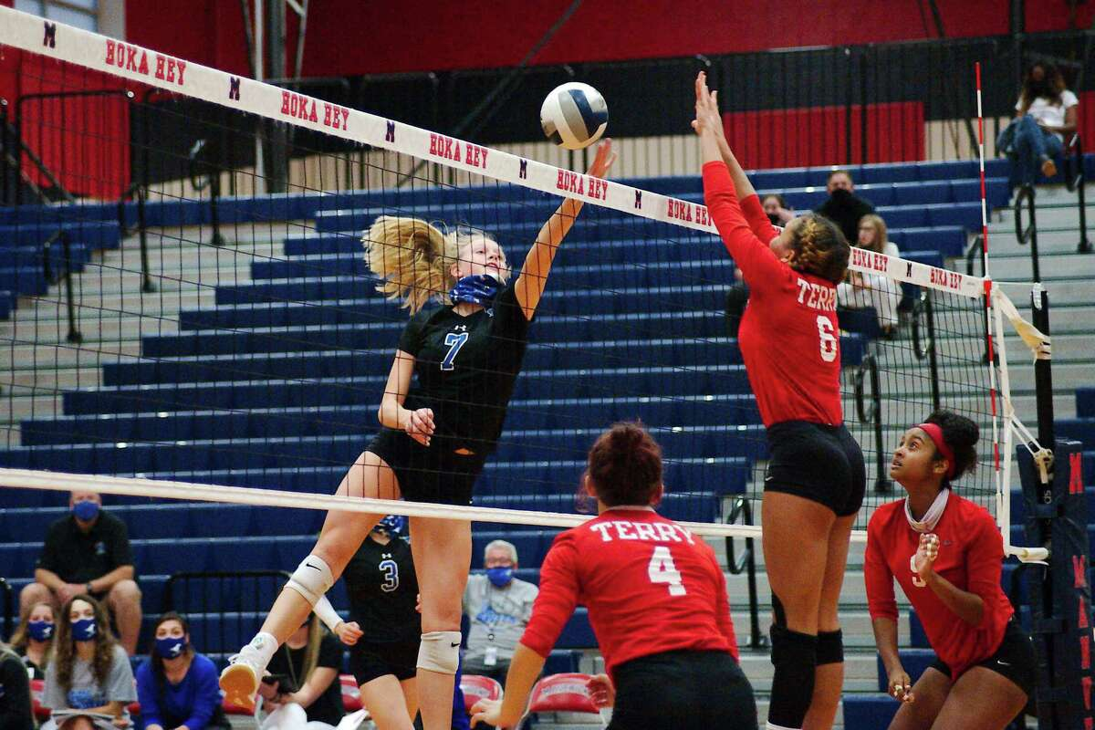 Friendswood's Sarah Sitton (7) tries to tip the ball past Terry's Raven Jordan (6) Tuesday, Nov. 24 at Manvel High School.
