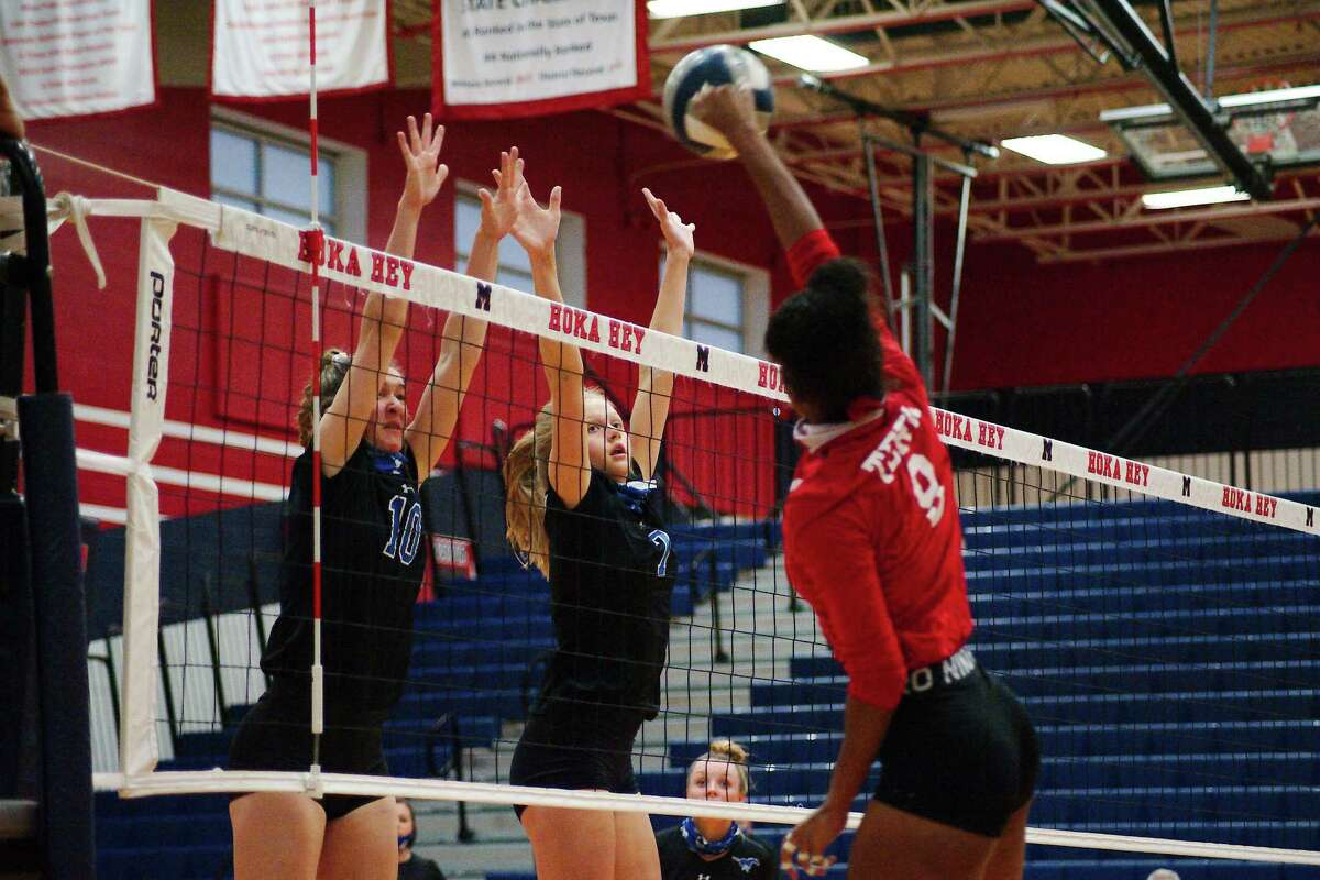 Terry's Jayden Garza (9) tries to hit a shot past Friendswood's Jordan Norwood (10) and Sarah Sitton (7) Tuesday, Nov. 24 at Manvel High School.