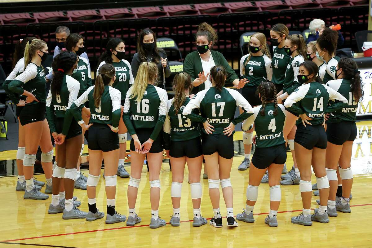 Reagan coach Rachel Torvik and the Rattlers, shown huddling during their Class 6A second-round playoff match with San Marcos at Littleton Gym on Nov. 23, 2020, is headed back to the state tournament.