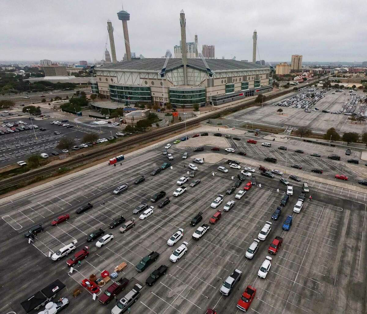 Vehicles are lined up to receive nourishment from the San Antonio Food Bank at the Alamodome on Tuesday morning, Nov. 24, 2020. More than 2,000 families received packages.
