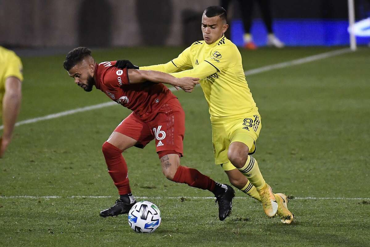 Randall Leal (right) pressures Toronto FC's Auro Jr. in expansion Nashville's surprise playoff win.
