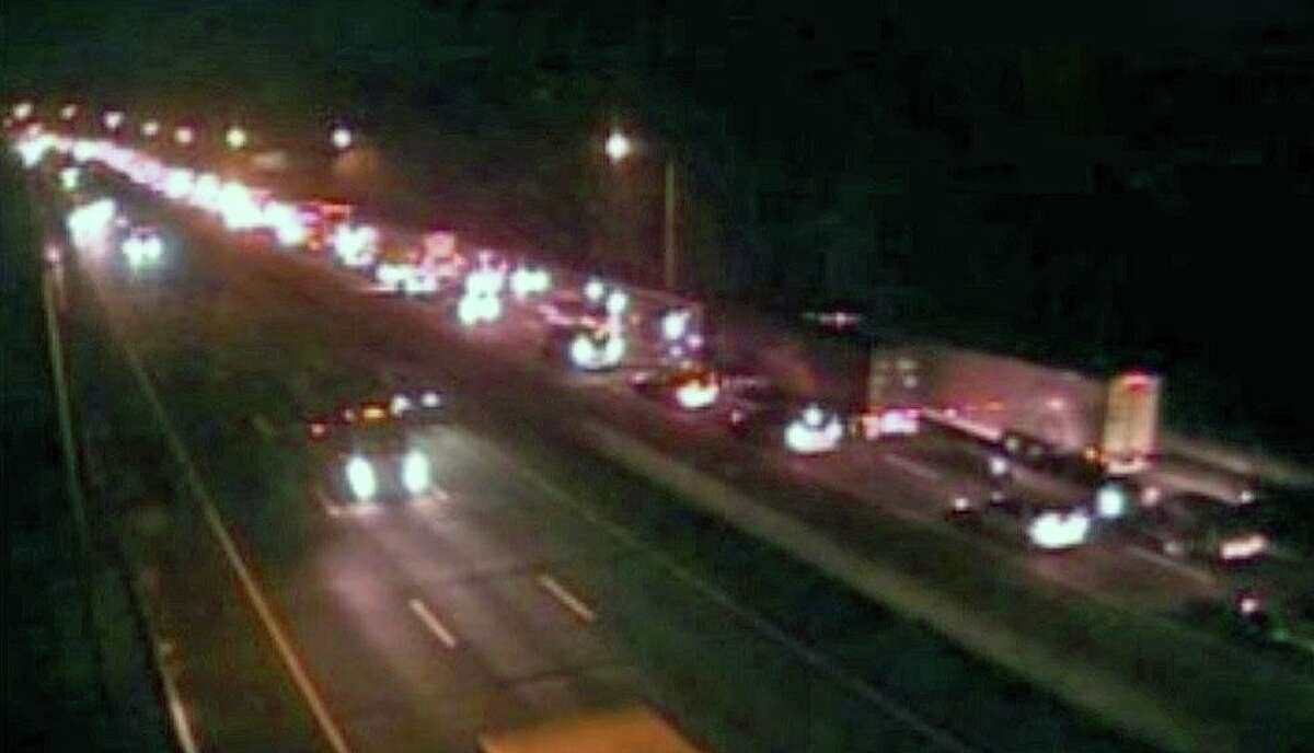 Traffic backed up in the area of a tractor-trailer fire, which was reported shortly before 6 a.m., on I-95 south between exits 18 and 17 in Westport, Conn., on Wednesday, Nov. 25, 2020.
