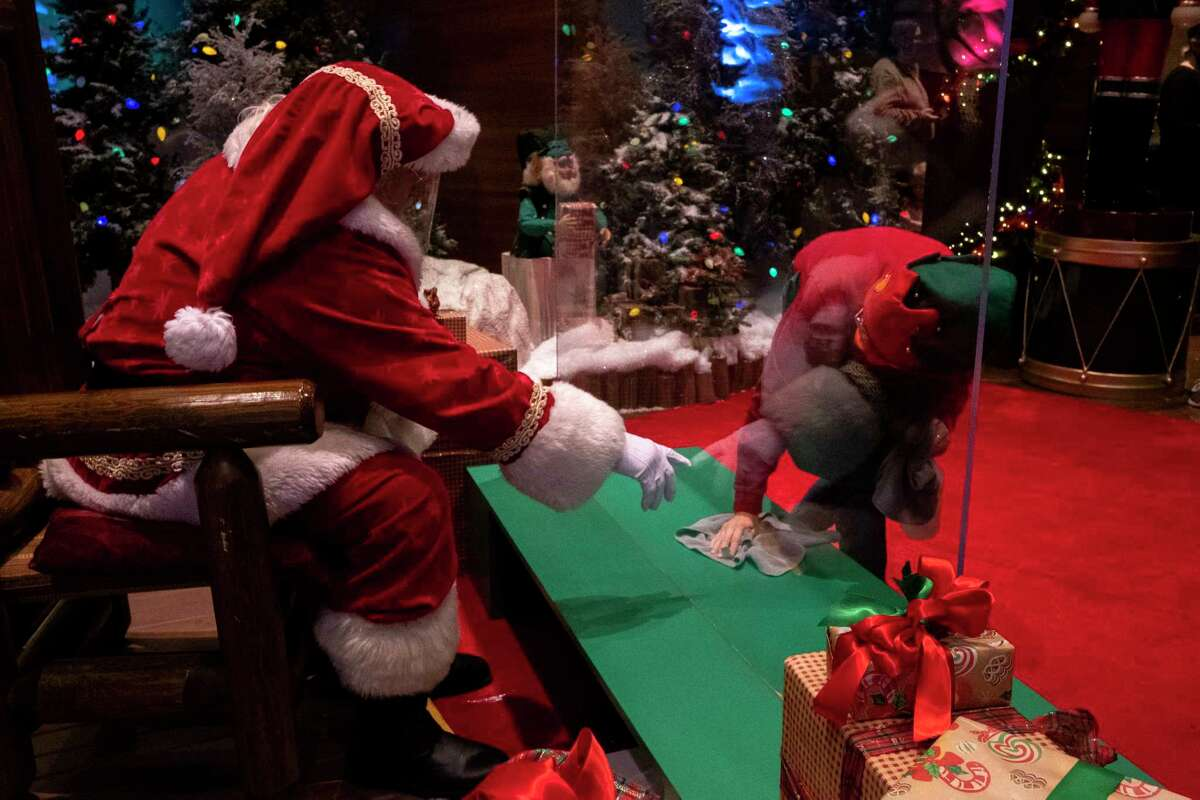Santa's helper works to keep things disinfected at the Springfield Bass Pro Shops store in Springfield, Mo.