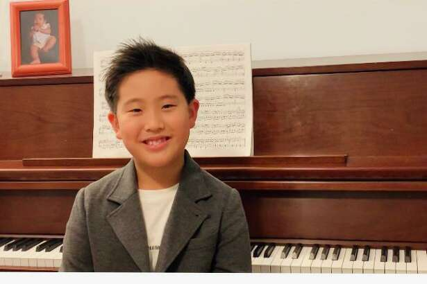 Shelton resident Minho Chung, 8, will perform in the 14th Playing By Heart, a concert featuring the advanced students of Wilton pianist and teacher Kyong Hee Cho. The performance will be Sunday, Nov. 29, at 4 p.m. on YouTube.