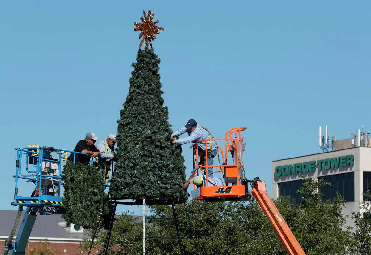 Employees with Conroe's Park and Recreation Department work to install the city's 32-foot Christmas tree at Heritage Place Park, Tuesday, Nov. 17, 2020, in Conroe. The city's annual Christmas tree lighting will be held on Dec. 1 at 6 p.m. with a holiday festival scheduled for Dec. 12 from 11:00 a.m. to 4:00 p.m.