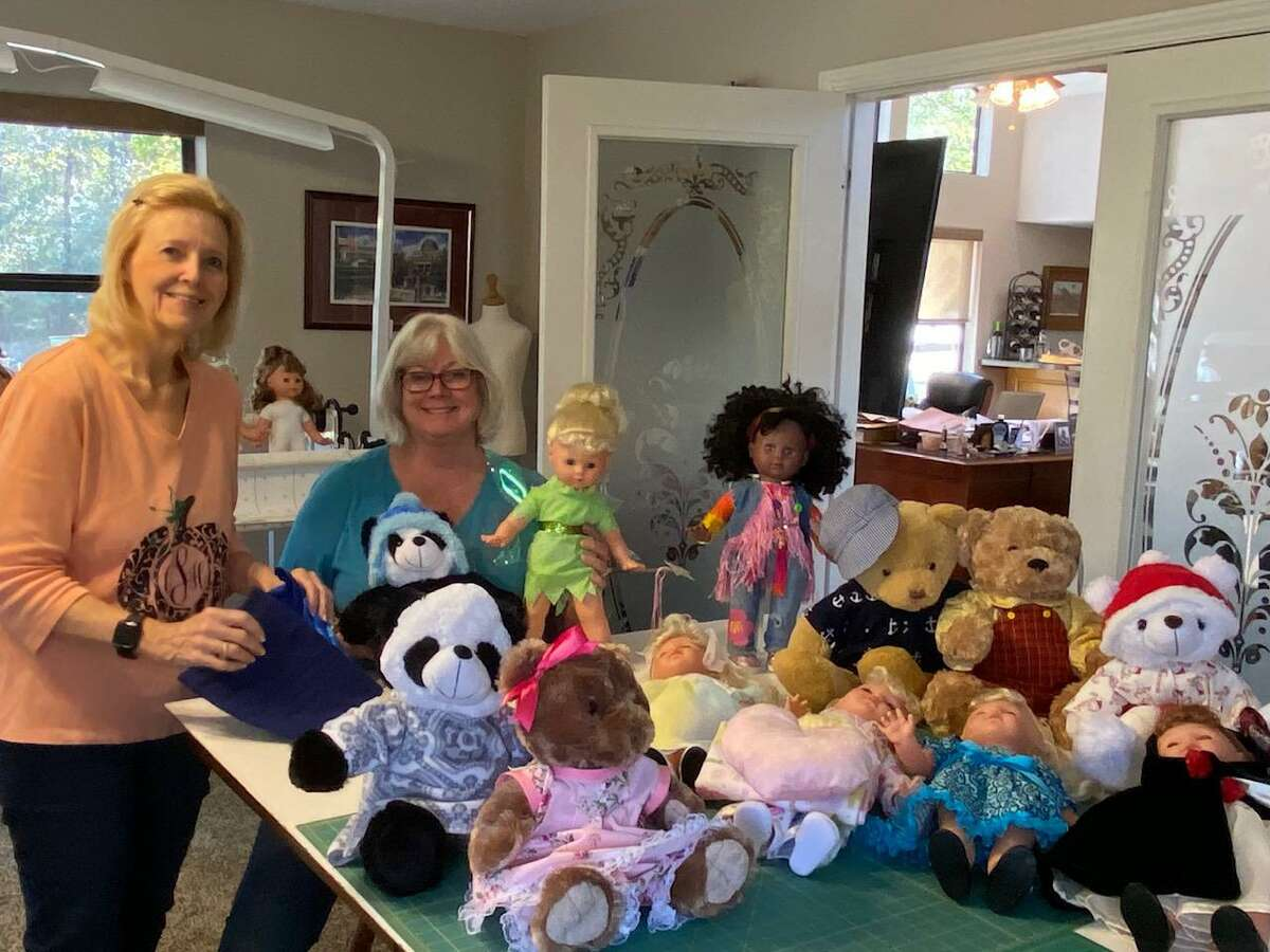 Cindy Sellars shows her sister, Jenny Cantrell, the dolls and bears that she has dressed for this year's Salvation Army Christmas Doll and Bear Tea. This year's event will take place at Conroe's First Baptist Church on Dec. 6.