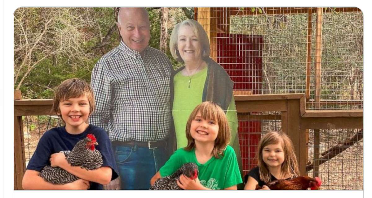 Missy and Barry Buchanan, in cutout form, in a photo with their grandchildren.