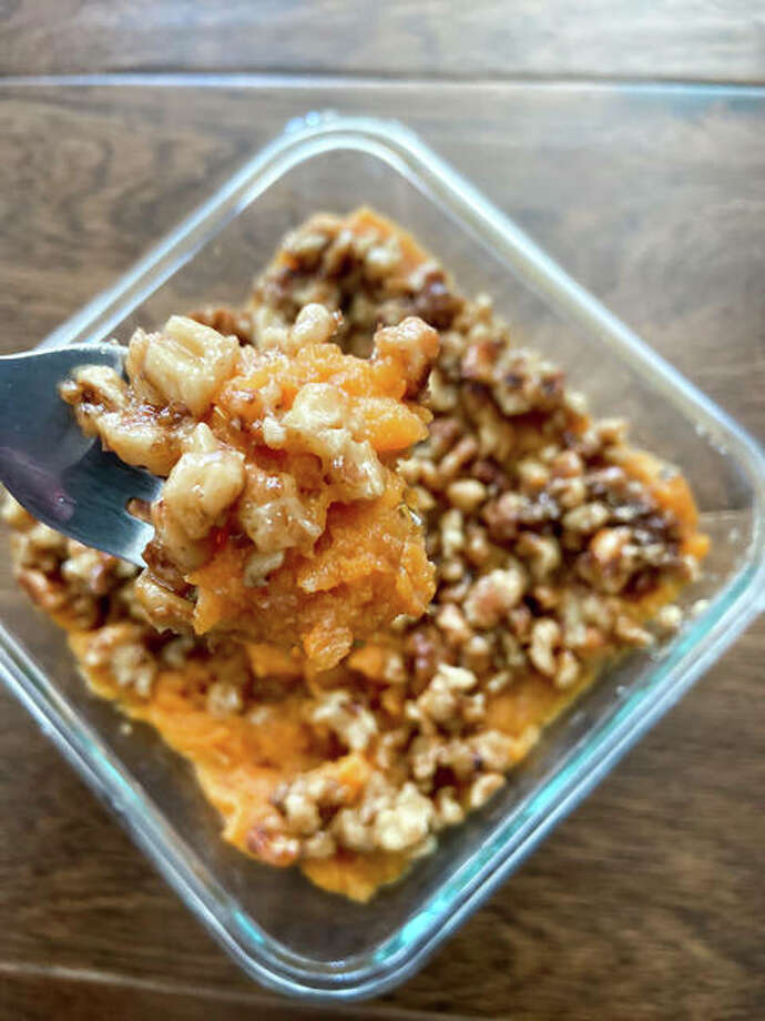 The mashed sweet potatoes with a brown sugar walnut crust dish is sweet with a kick from the cayenne pepper. Photo: Courtesy Of Rachel Tritsch | For The Intelligencer