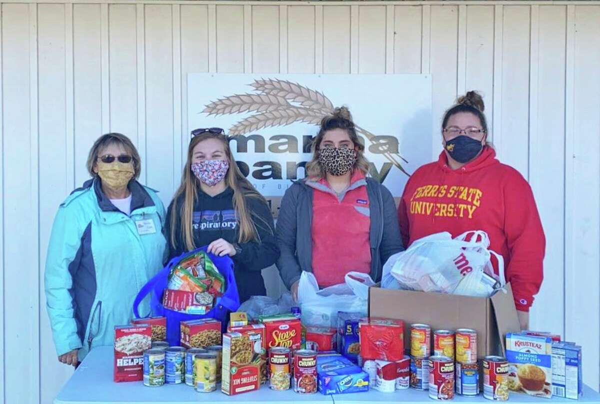 Pictured is (from left): Bonnie Clark, executive director of the Manna Pantry of Big Rapids, Kourtney Jones, Brianna Joldersma, and Leslie Joseph. The Ferris State students recently donated 100 pounds of food to the pantry. Not pictured is Katie Manesfield, Debbie Osborn and Elyna Scheyltma. (Courtesy photo)