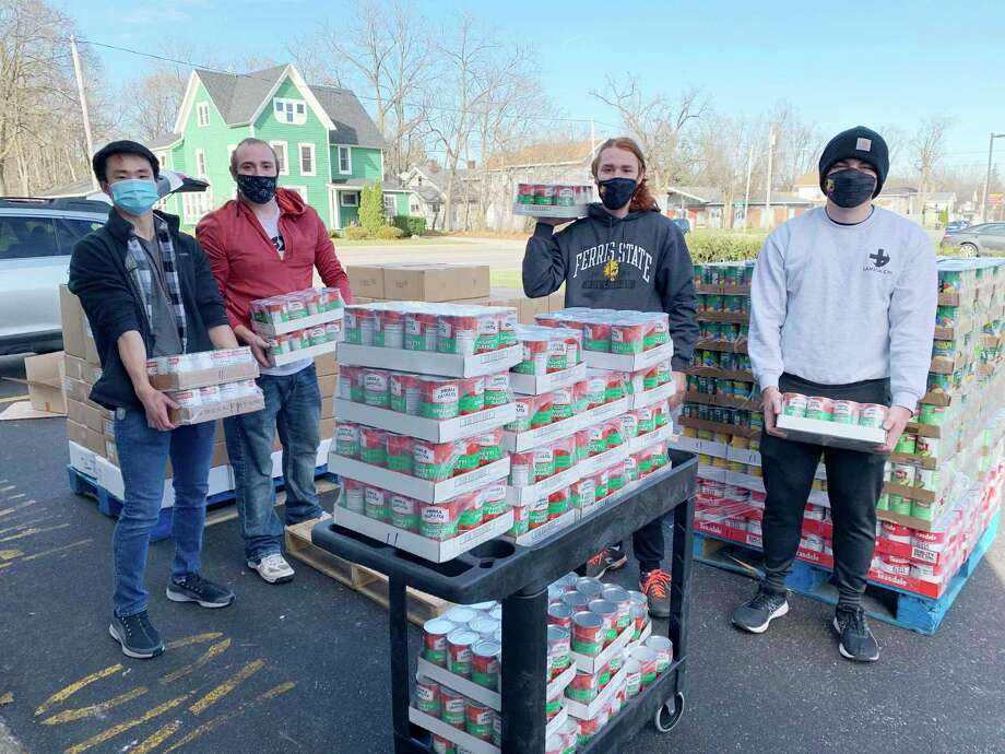 The Ferris Mixed Martial Arts Club — consisting of Patrick Wagner, Connor Wagner, Zachery Leslie and Connor Lowe — is pictured helping with food that was donated to the Manna Pantry of Big Rapids. (Courtesy photo)