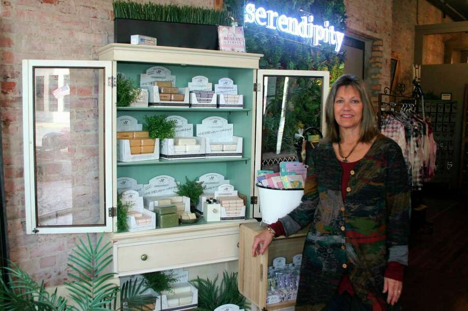 Jeannette Line, manager of Serendipity in downtown Big Rapids invites shoppers to come and check out the line of specialized soaps, along with many other local made specialty items throughout the store. Serendipity will be offering a variety of specials throughout the holidays so shoppers can find the one-of-a-kind gift.. (Pioneer photo/Cathie Crew)