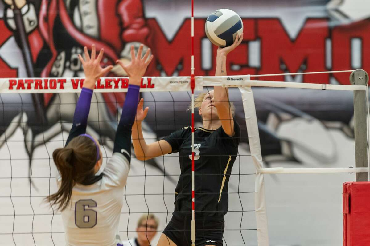 Nederland's Rylee Bolser (3) puts a shot over the net in the early going. The Nederland Lady Bulldogs Volleyball team traveled to Baytown to take on the Fulshear Lady Chargers in Region 3 AAAAA Area Playoffs Tuesday night. Photo made on November 24, 2020. Fran Ruchalski/The Enterprise