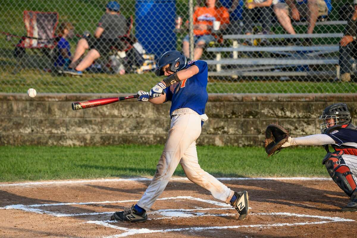 Midland's Ben Haney hits a line drive during the July 29, 2019 Junior League state championship game against Macomb Township in Grand Rapids.