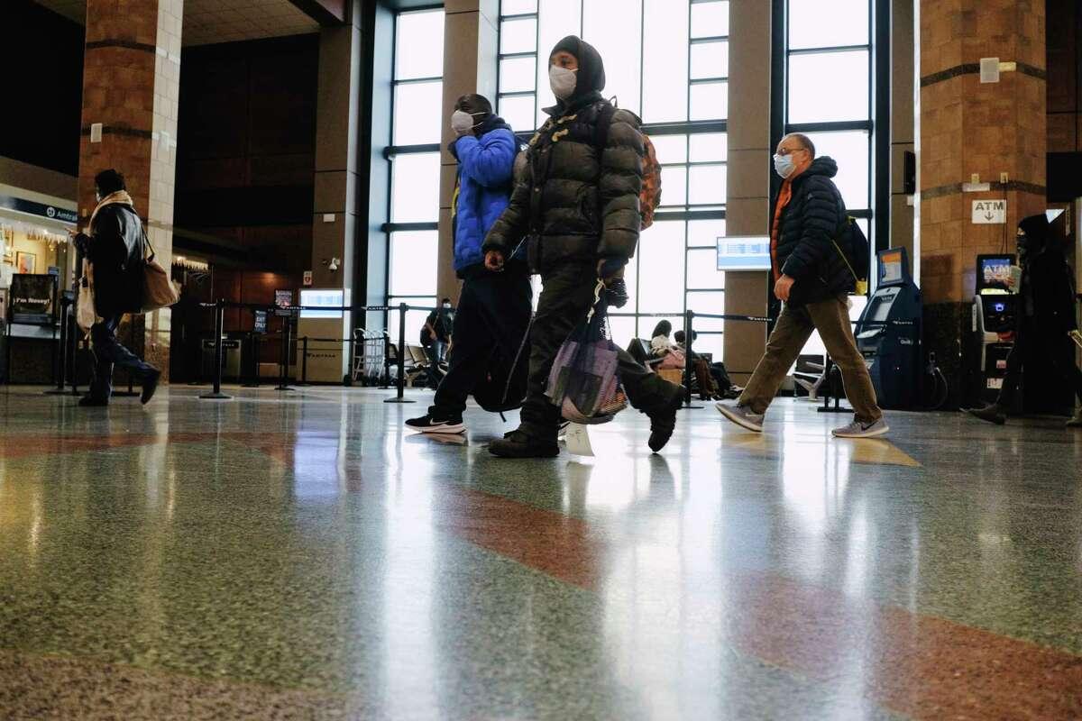 Travelers arrive at the Albany-Rensselaer Train Station on Wednesday, Nov. 25, 2020, in Rensselaer, N.Y. (Paul Buckowski/Times Union)