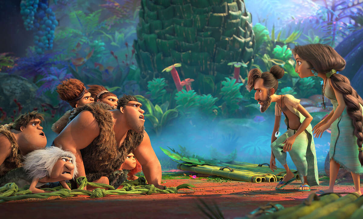 The Croods (voiced by, from left, Clark Duke, Cloris Leachman, Kailey Crawford, Nicolas Cage, Catherine Keener and Emma Stone) meet the Bettermans (from right: Leslie Mann and Peter Dinklage) in