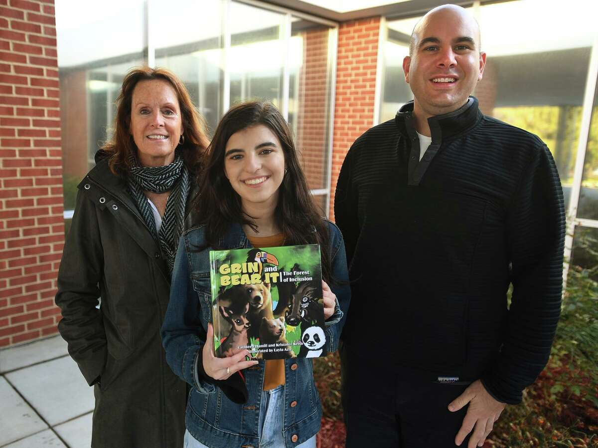 From left, Fairfield Woods Middle School teacher Cathleen Hamill, Roger Ludlowe High School student Layla Aziz, 16, and Fairfield Woods Dean Kristofer Kelso collaborated on a book about inclusion,