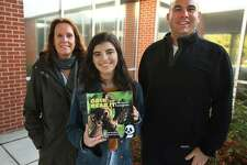 "From left, Fairfield Woods Middle School teacher Cathleen Hamill, Roger Ludlowe High School student Layla Aziz, 16, and Fairfield Woods Dean Kristofer Kelso collaborated on a book about inclusion, ""Grin and Bear It, The Forest of Inclusion."""