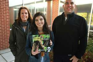 """From left, Fairfield Woods Middle School teacher Cathleen Hamill, Roger Ludlowe High School student Layla Aziz, 16, and Fairfield Woods Dean Kristofer Kelso collaborated on a book about inclusion, """"Grin and Bear It, The Forest of Inclusion."""""""