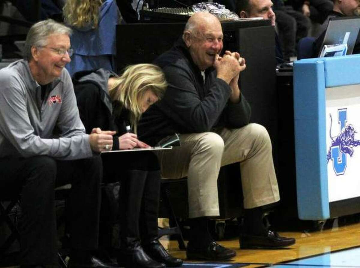 Former Edwardsville High School basketball coach Bud Vallino, right, jokes around with an official while helping out as an assistant coach with the Triad girls basketball team.