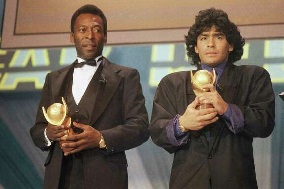 "FILE - In this March 1987 file photo, Pele, left, and Maradona hold ""Sports Oscar"" trophies in Milan, Rome. The Argentine soccer great who was among the best players ever and who led his country to the 1986 World Cup title before later struggling with cocaine use and obesity, died from a heart attack on Wednesday, Nov. 25, 2020, at his home in Buenos Aires. He was 60."