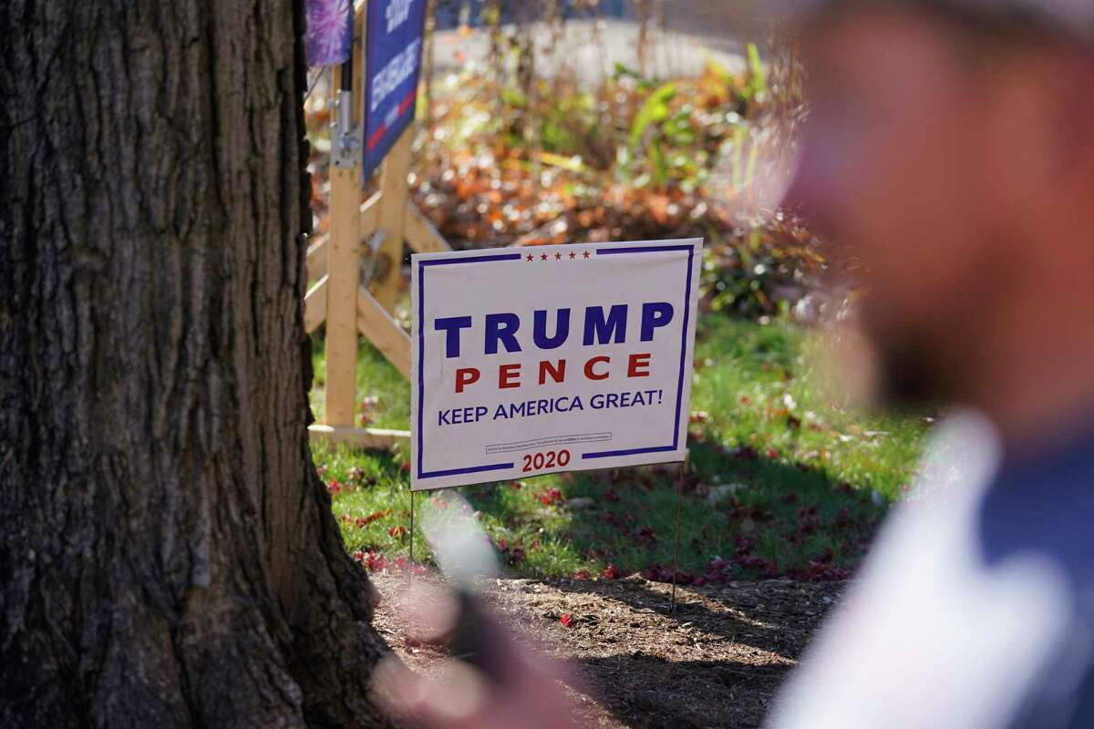A President Donald Trump sign sits in a yard Nov. 11, 2020 - a week after the election - in Terre Haute, Ind.