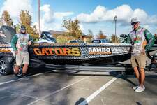 Anglers Brett Fregia, left, and Jack Tindel stand by their bass boat Thursday afternoon outside the Ron E. Lewis Library at Lamar State College Orange greeting supporters before they leave for the Carhartt Bassmaster College National Championship Friday morning. Photo made on October 22, 2020. Fran Ruchalski/The Enterprise