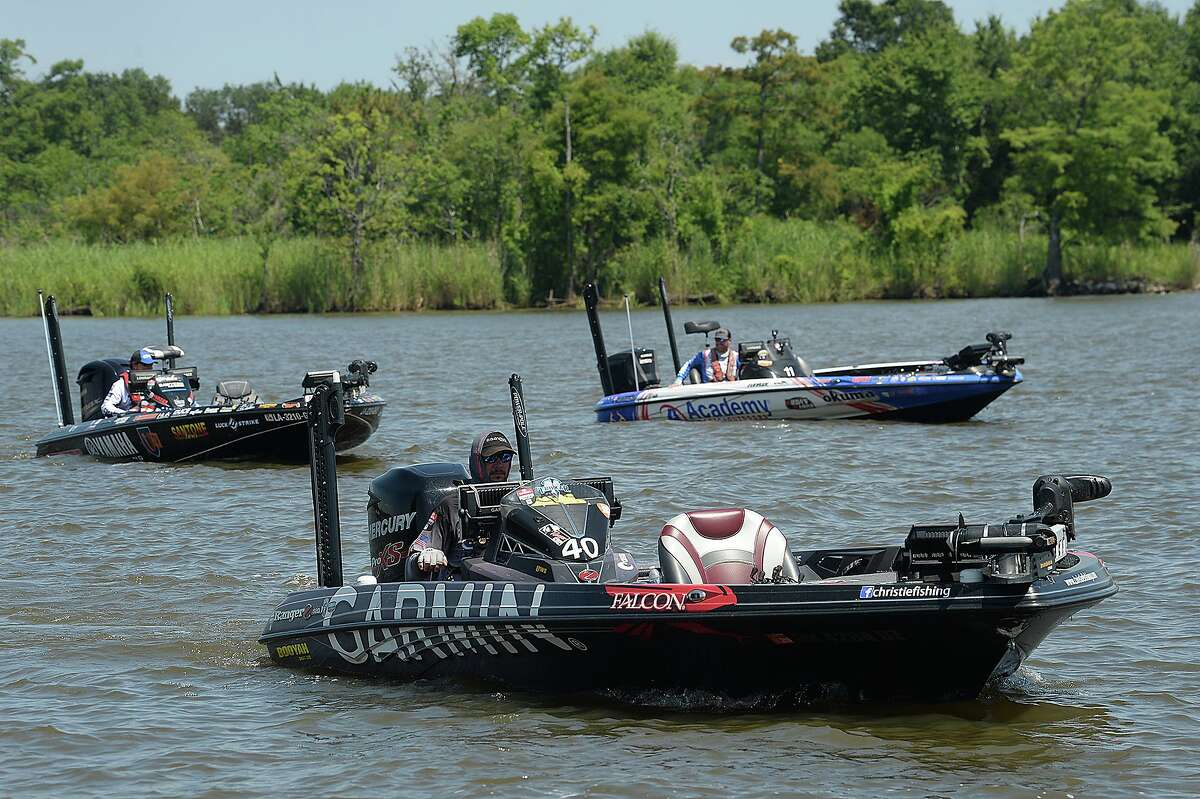 Anglers make their way back to the docks on the opening day of the Bassmaster Elite Series fishing tournament in Orange. The competition continues through Sunday with daily launch times of 6:05 a.m. and weigh-ins beginning at 3 p.m. Photo taken Wednesday, June 6, 2018 Kim Brent/The Enterprise