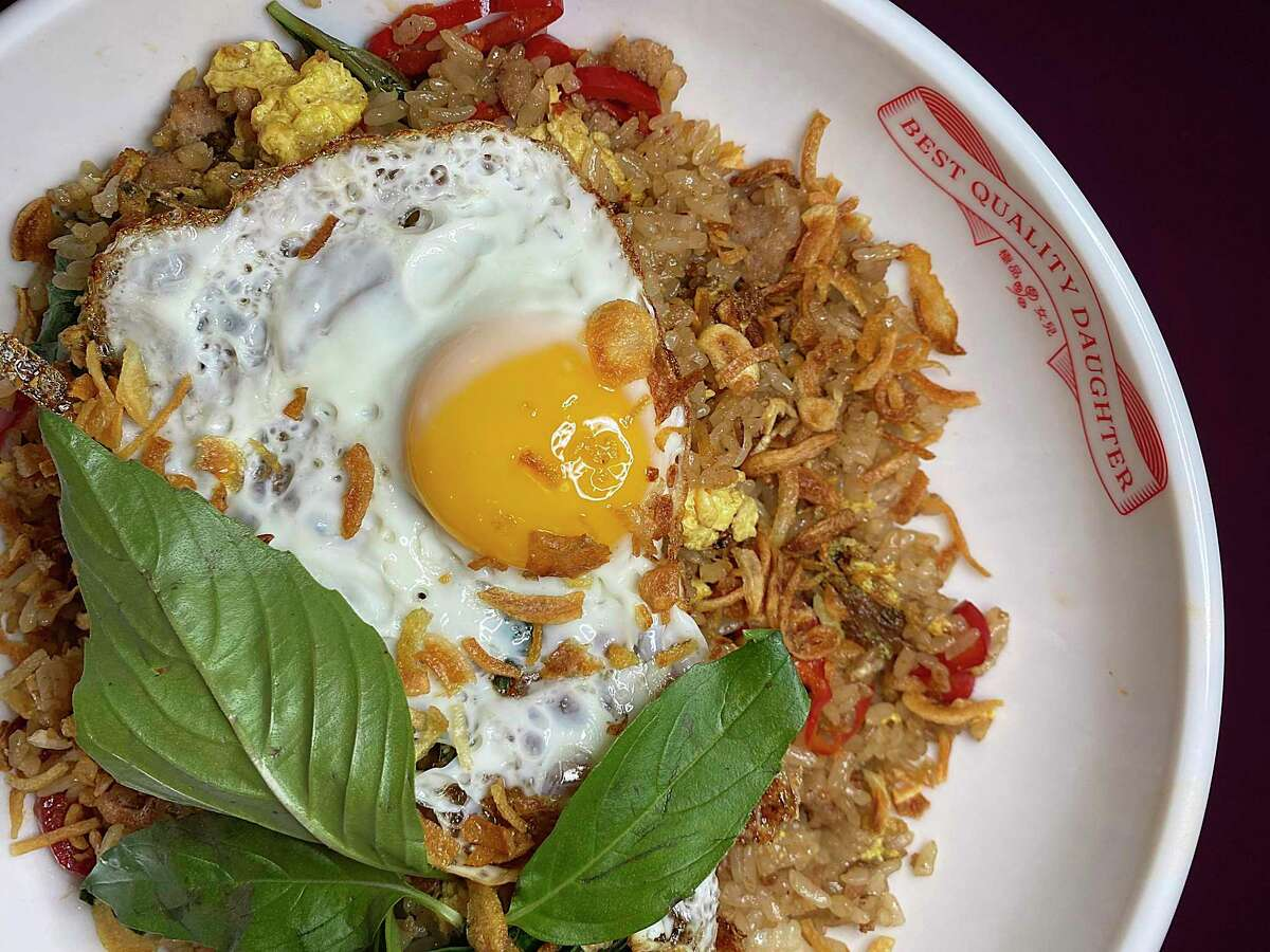 Phat Khaprao Pork Fried Rice incorporates pickled chiles, Thai basil, crispy shallots and fried egg at Best Quality Daughter at the Pearl.