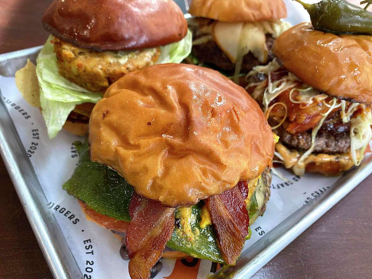 Burgers include, clockwise from front, the Mercedez Bunz, the Beach Bunz, Show Bunz and the Bunzai at Bunz Handcrafted Burgers.