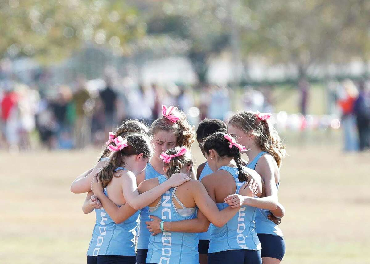 Kingwood runners gather before the Class 6A race during the UIL State Cross Country Championships at Old Settlers Park, Tuesday, Nov. 24, 2020, in Round Rock.