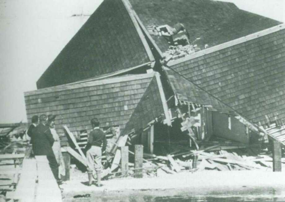 People inspect buildings on Fairfield Beach wrecked by the Hurricane of 1938. Photo: Contributed Photo / Fairfield Citizen contributed