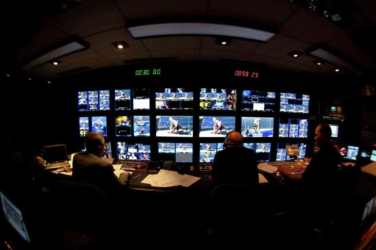 The control center for WWE TV broadcasts is contained in a truck decorated with images of the stars. (WWE)