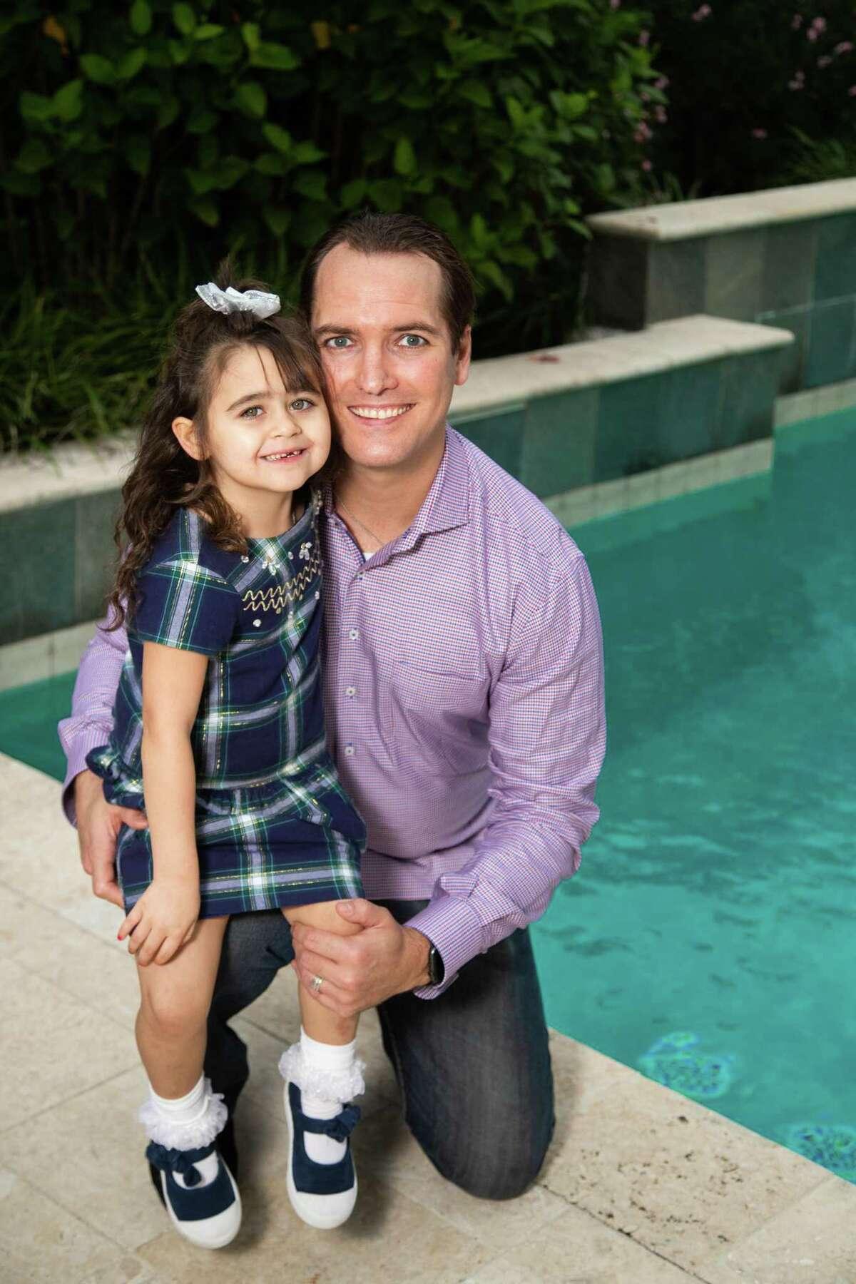 Reed Looper with his adoptive daughter Sadie Looper, 5.