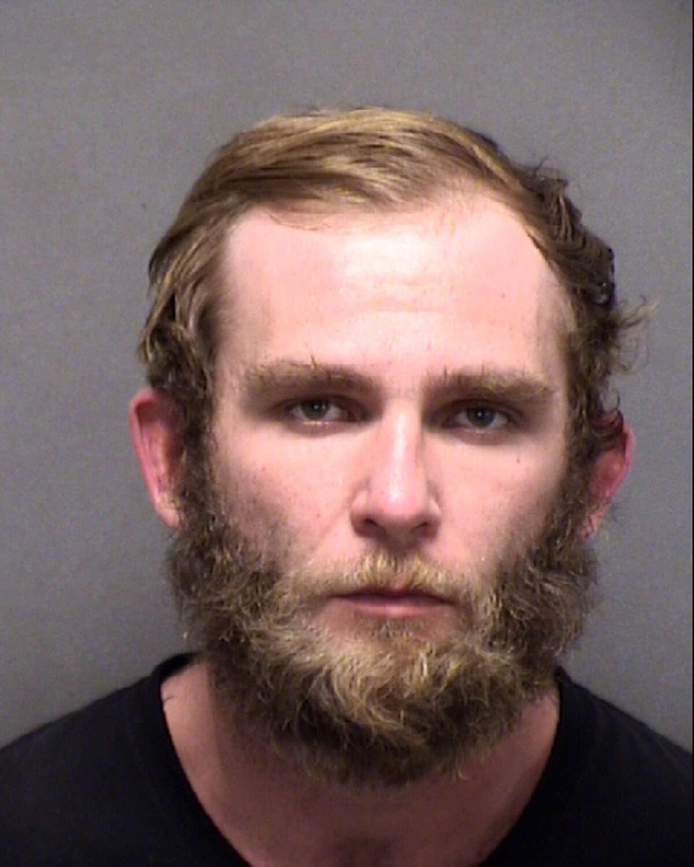 Dalton Austin Brown, 28, a former teacher at John Jay High School, was charged with making terroristic threats against a public servant.