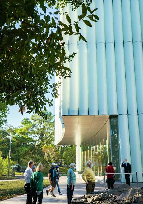 People walk near the entrance to The Museum of Fine Arts Houston's new Nancy and Rich Kinder Building on Wednesday, Nov. 18, 2020, in Houston.
