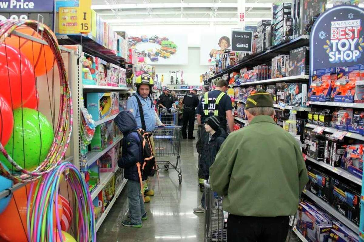 Area children shop with heroes during a previous Shop With a Hero event in Bad Axe. This year's event will be held online due to the coronavirus pandemic. (Tribune File Photo)
