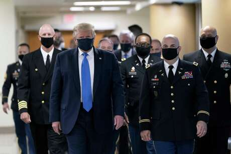 President Donald Trump wears a protective mask while visiting Walter Reed medical center on July 11.