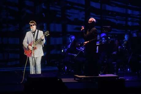 """A hologram of Roy Orbison performs with a live orchestra during 2018's """"The Hologram Tour"""" at the Smart Financial Centre in Sugar Land."""
